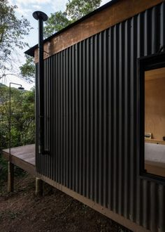 The Brazil based architecture firm, Silvia Acar Arquitetura, were responsible for the design of this small forest cabin. Dubbed Chalet M, the cabin can be House Cladding, Metal Cladding, Metal Siding, House Siding, Metal Facade, Metal Roof, Forest Cabin, Forest Home, Casas Containers