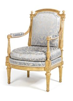 A LOUIS XVI CARVED GILTWOOD FAUTEUIL ATTRIBUTED TO GEORGES JACOB CIRCA 1780