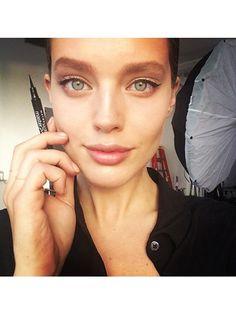 Emily DiDonato's thin cat eye and glossy lips | allure.com