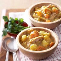 16 ounce package frozen stew vegetables  4  large chicken thighs, skin removed (1 1/2 to 1 3/4 pounds)  Salt and ground black pepper  1  10 3/4 ounce can condensed cream of potato soup  2  teaspoons curry powder  1  tablespoon snipped fresh cilantro
