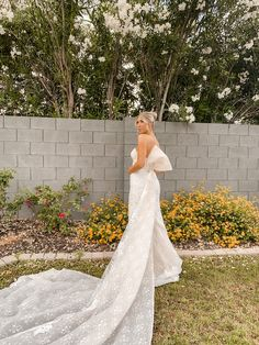 Drawing inspiration from the runway, this sheath wedding dress is detailed with a detachable, exaggerated bow that floats into a dramatic sweep train. A scalloped trim along the hem, crafted of two different types of lace, finishes the look. | #laceweddingdress #modernweddingdress | Style CWG880 | Shop this style and more at davidsbridal.com | Photo by: @amandalynrose Wedding Dresses With Straps, Wedding Dress Train, Applique Wedding Dress, Glitter Bridesmaid Dresses, Wedding Dress Crafts, Types Of Lace, Tea Length Dresses, Glamorous Wedding, Scalloped Lace