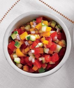 A refreshing and low-fat alternative to the usual creamy dips that are always at summer barbecues, this brightly colored salsa is great with crostini or endives (or by the spoonful).