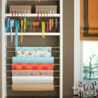 Organize the clutter of gift-wrapping with poles mounted between shelving units. Take out a shelf, insert expandable curtain rods, and you've got a wrapping station.