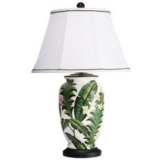 Sail away with Kichler's new Caymen table lamp! This hand-painted porcelain lamp will get you dreaming of tropical islands with its leaf and floral detailing over a clean, white background. Complemented by a soft white shade with a black soutache trim, this table lamp will excite guests with the feeling of the tropics.  www.texasbrightideas.com