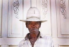 "This photo was taken in the streets of the town of Trinidad, Cuba, in January 2011. I noticed this man's eyes from a street away and his look gave me chills. I spoke to him and he simply nodded and indicated that he would let me take his photo. Most likely a ""campesino"" (farmer), he was calmly observing the busy street activities taking place in front of him. His aura was peaceful; I feel as if I captured his warm and balanced energy."