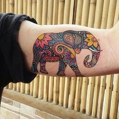 Colorful biceps African elephant tattoo