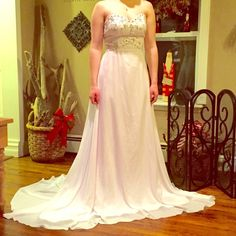White crystal/beaded wedding dress! Never worn! Never worn wedding dress! Has a gorgeous train and is very light! Has gorgeous crystals and beading at the top. Open to reasonable offers Dresses Strapless