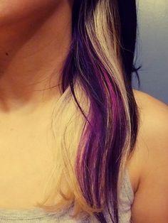 Dark brown hair with blonde highlights and purple streaks