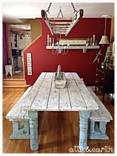 This hand built farm table was made using authentic barn wood and is 8 ft long and 40in wide. This table has a distressed painted finish and two matching benches. We also take custom orders for farm t