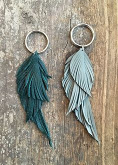 Upcycled leather feather keychain approximately 4 5 5 5 inch length 8 leather color choices available black blue red tan dark grey light grey light pink or teal silver split key ring diy leather cord organizer Diy Leather Earrings, Diy Earrings, Leather Jewelry, Feather Earrings, Quilling Earrings, Leather Bracelets, Metal Jewelry, Jewelry Necklaces, Hoop Earrings