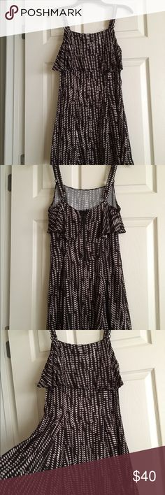 NWT Free People Dress NWT Free People Dress.  Shelf like layer top. Ticket indicates black comb but looks like a very dark brown with tan and white.  Size 2 Free People Dresses