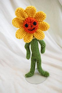 Howdy! This is Daisy, one of Oswald's best friends! She likes to rollerskate, collect leaves, and ride her unicycle! She's got a cute smile, pretty yellow petals, and a big orange face! What's not to love? Crochet this sweet flower from one of the greatest kids' shows, Oswald. Your kids will love cuddling with all the characters while they watch adventure unfold in Big City :)