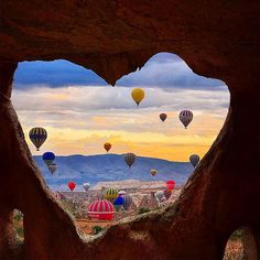 Another amazing shot of hot air balloons floating over Cappadocia ❣✨ The opening of the cave looks like a ❤️ Sweet!!! Pic by @kyrenian ✨ . . #naturalplease#tourism#wanderlust#travel#traveling#instatraveling#turismo#viagem#travelgram#vacation#photooftheday#picoftheday#life#cool#awesome#amazing#destination#airballons#lifestyle#love#cappadocia#turkey#cave#balloons#sky#skyporn#landscape#view#panorama#heart