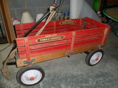 Vintage Radio Flyer wagon I saved coins to buy one for our girls. My mom found out and bought the second half. We wore the tires off that wagon. I cried when the axle broke.