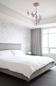Modern silver gray bedroom with silver metallic wallpaper accent wall, gray linen modern bed, crisp white hotel bedding with white stitching, lilac gray curtains window panels and polished nickel winding Omega Chandelier. White And Silver Bedroom, Gray Bedroom, Trendy Bedroom, Bedroom Decor, Bedroom Ideas, Bedroom Romantic, Master Bedrooms, Bedroom Colors, Wall Paper Bedroom