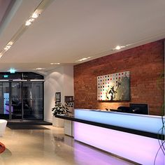 London Architects Tate Hindle, designed this glowing reception desk using back lit Varia Ghost with 3form lighting solutions and fabrication.  #interiors #interior design #3form #london  #office  #Tate Hindle #varia #eco design