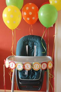 I want to decorate Troy's high chair! And I love the colors: green, yellow, and orange-- all the brights!