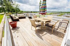 No shortage of entertaining space on this deck overlooking the river!