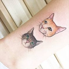 Two illustrative style cat head tattoos on the ankle. Tattoo...