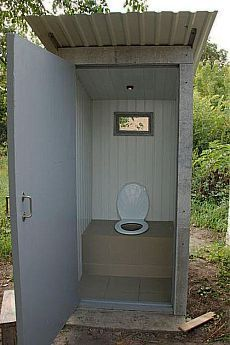 Outhouse with tile. Would be easy to clean!