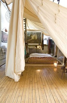 Put the bedroom under a gigantic canopy. | 22 Brilliant Ideas For Your Tiny Apartment It'll give the illusion of a private fort