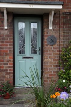 Ludlow 2 composite door in chartwell green on rosewood frame with Abstract glass.