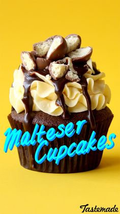 Choc Malt cupcake with malt vanilla frosting, a drizzle of choc sauce and crushed matlesers on top.