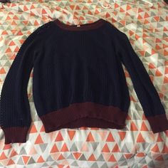 Navy holed sweater with maroon Navy big-holed sweater with maroon on the ends of the sleeves, collar and bottom of the sweater. Super cute and only worn a few times! Originally from Jc Penny and I wore a Navy cardigan underneath it because it is see through. Timing Sweaters Cowl & Turtlenecks