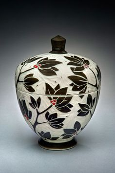 Karen Newgard Pottery. I really like the carved effect and the small pop of red! <3