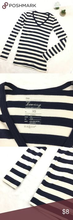 The Bowery Striped Tee from Gap XS This tee from Gap is stunning! It is part of the Bowery Collection, and has vivid striping throughout. A v-neck makes this perfect for daily wear, and the stretchy fabric makes movability easy!  (I have this tee in black and I LOVE it! This just isn't my size.)  This piece is in amazing condition. It can be said as NWOT.   Smoke free home as always. Bundle this with another listing (or more!) and receive a discount! ❤️ GAP Tops Tees - Long Sleeve