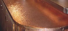 Hammer copper countertop- Made from stainless steel from stainlessliving.com. Sweet looking