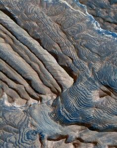 The Arabia Terra are highlands thought to be one of the oldest terrains on Mars. This is an image about 1.2 miles across showing part of the Arabia Terra, which stretches 2,800 miles across the surface. The uniform layers are each about 33 feet high.