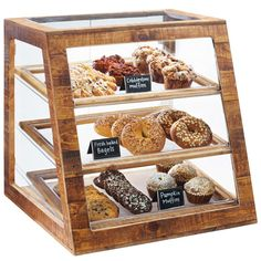 """Showcase all of your tempting muffins, cookies, and treats in a stylish way with this Cal-Mil 3432-99 Madera reclaimed wood 3 tier slanted bakery display case! This display case includes (3) 13"""" x 18"""" clear trays that are removable for easy cleaning. Compared to self serve doors, the full service style doors give your staff control of when baked goods are removed from the case. <br><br> Perfect for your coffee shop, bakery or cafe, this three-tier case utilizes vertical ..."""
