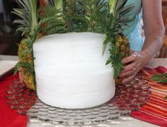 cascading fruit displays | Slice 2 pineapples in half, lengthwise, keeping the top greens intact ...