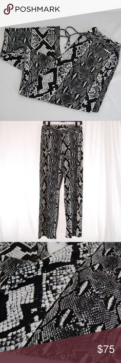 """🆕 Michael Kors Snake Print Palazzo Pants Elastic waist with drawstring (with silver MK knobs at end) - see pics.  Unlined with a great fabric and feel.  These pants have pockets!   Medium weight - bouncy fabric. So comfortable!  Wide leg / palazzo style.  Excellent condition - worn once.  Approximate measurements (taken flat): Waist = 15-20"""" (elastic) Thigh = 13"""" Inseam = 30.5"""" Cuff / Ankle = 12"""" Michael Kors Pants Wide Leg"""