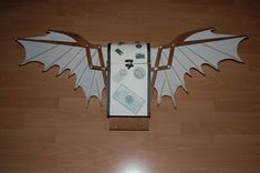 Steampunk auto-folding wings tutorial.  I'd probably stain the white to a cream colour.