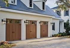 At Banko Overhead Doors, Inc., we carry a wide selection of residential garage doors. Check out our Canyon Ridge collection of carriage house style garage doors with faux wood overlays! Energy efficient insulation in a variety of designs and colors. Garage House, Garage Door Lights, Faux Wood Garage Door, Garage Door Colors, Modern Garage Doors, Best Garage Doors, Garage Door Styles, Garage Door Design, Garage Lighting