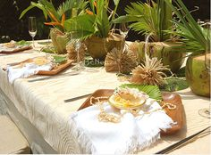 Beach wedding place setting - using wooden plates and seashell accents
