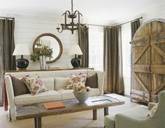Love the vintage wood cabinet in this room