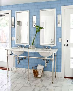 Blue glass subway tiles set a soothing backdrop for this his-and-hers master bath with matching sinks, mirrors and sconces. | Via chicoastalliving.blogspot.com