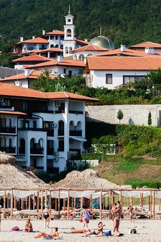 Sveti Vlas, Bulgaria. Sveti Vlas is a beautiful coastal town located 5 km north of Sunny Beach resort and 9 km from Nessebar. The town is at the foot of the southern slopes of the Balkan Mountains, in the northern part of Burgas Bay. (V)