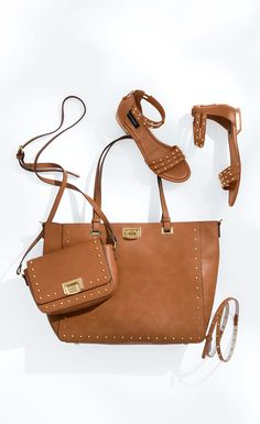 """Introducing the """"carry-everything"""" tote in saddle, accented by goldtone hardware. For styling versatility, we gave it a removable crossbody strap. 