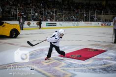 A youth hockey player shoots the puck during the intermission game on Opening Night 2015. #Fuelify