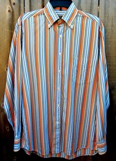 d5c7adb6 An nice looking Paul & Shark Yachting shirt in pre-owned condition. Pit to  Stripe pattern=white,orange,brown,tan,& purple.