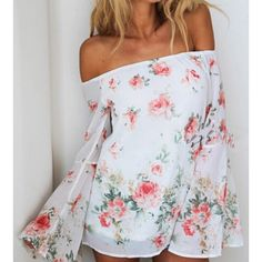 Coming Soon Super sexy, floral print, slash neck , bell sleeve blouse. Tops Blouses
