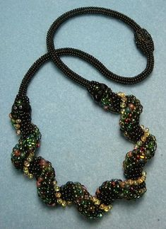 patrickduggandesigns: Green Zig Zag - example of Indespiral with different sized beads - done in Zig Zag Pattern, Peyote Stitch, Beaded Necklaces, Bead Crochet, Bead Weaving, Beaded Embroidery, Beads, Jewelry, Kittens