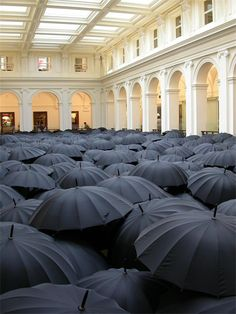 Umbrella art installation in Melbourne. Check out the site to see other examples of umbrellas as art media in installations around the world.