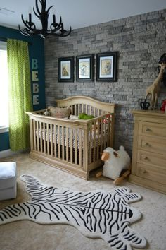 Faux stone wallpaper used in nursery. AWESOME!!!!! This blends in with the accent wall really well. Now... how to make this masculine wall more feminine