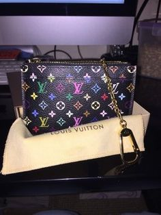 Authentic Louis Vuitton Cles Pochette Coin Purse Key Chain In Noir/Grenade. Get the lowest price on Authentic Louis Vuitton Cles Pochette Coin Purse Key Chain In Noir/Grenade and other fabulous designer clothing and accessories! Shop Tradesy now
