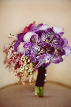 Very pretty asymmetrical purple vanda orchid bouquet.